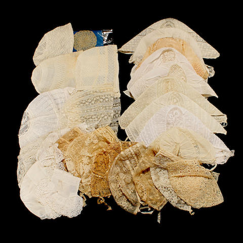 An 18th century muslin baby cap trimmed with Flemish style lace, with matching cuffed mittens