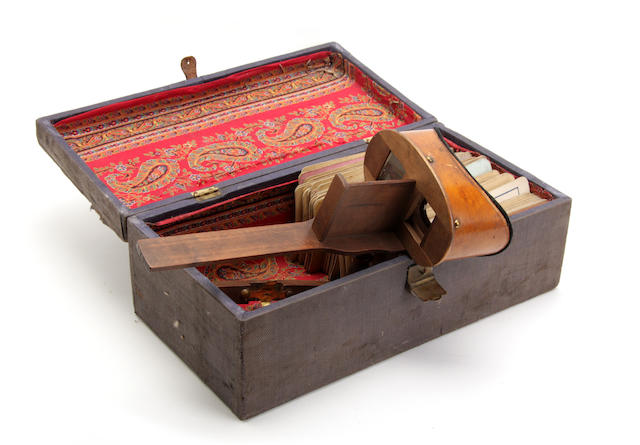 A Victorian stereoscopic handheld viewer with cards in case