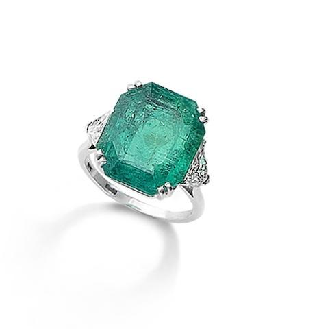 An emerald single-stone ring