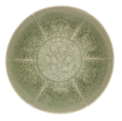 A Yaozhou carved 'floral scroll' green-glazed bowl  12th century
