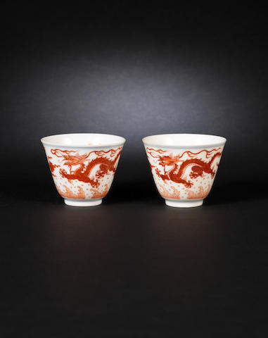 A pair of Chinese orange dragon cups bearing Qianlong marks