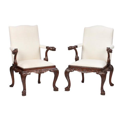 A pair of George II style mahogany open armchairs In the style of Giles Grendy