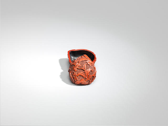 A small cinnabar lacquer peach-shaped box and cover Qianlong