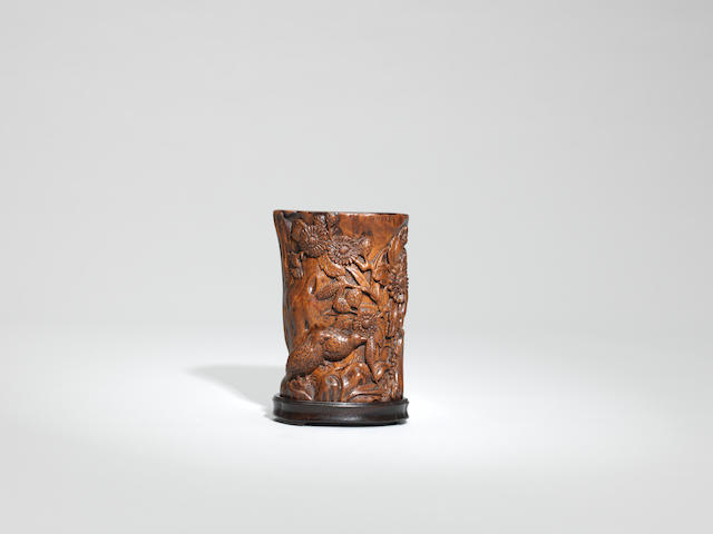 An exquisitely carved chenxiangmu 'quails' brushpot with zitan stand Mid Qing dynasty