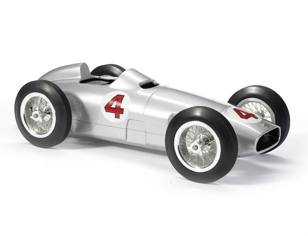 A Juan Manuel Fangio commemorative Mercedes Benz W196 pylon racing car, German, late 1990s,