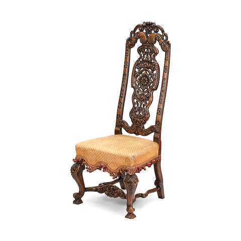 A walnut high back chair in the style of Marot first half 20th century