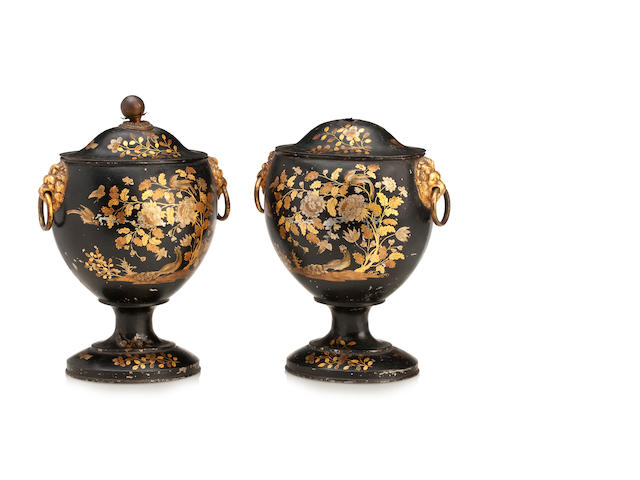 A pair of Regency toleware chestnut urns