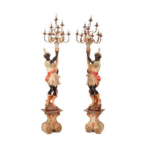 A pair of painted blackamoor torcheressecond half 20th century