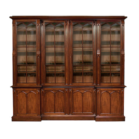 A mid 19th century mahogany inverted breakfront library bookcase cabinetIn the Gothic taste