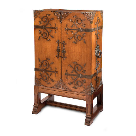 An oak and copper bound cabinet in the manner of Christopher DresserWith label inscribed for owner C.B. Caldwell, Clarges Street, Mayfair