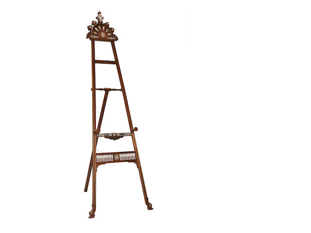 A late 19th/early 20th century walnut and inlaid easel in the style of Liberty & Co., LondonIn the Moorish taste