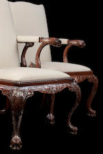 A pair of George II style mahogany open armchairs In the style of Giles Grendy, by Gostin of Liverpool, late 1970's/ early 1980's