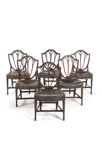 A set of six George III carved  mahogany dining chairsin the Hepplewhite style