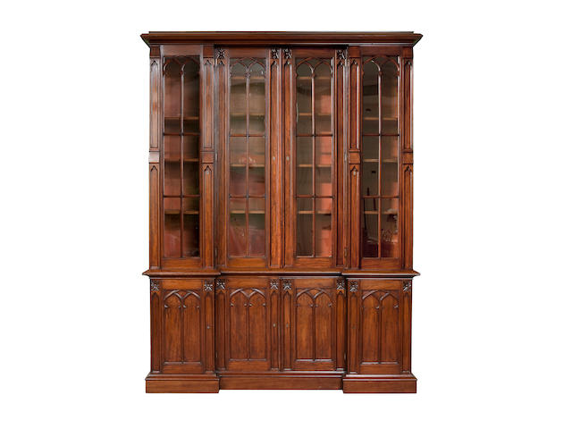 A mid-19th century mahogany inverted break-front library bookcase