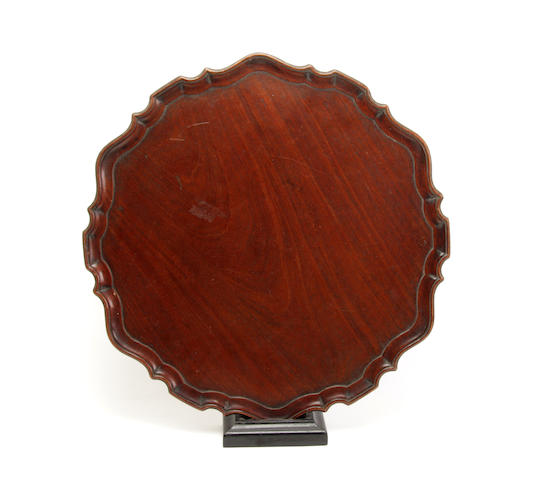 An early 20th century mahogany carved tray