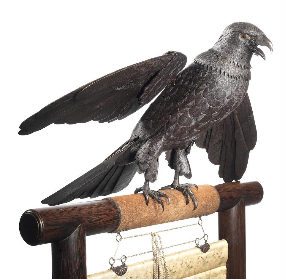 A fine and rare iron kusshin jizai (fully articulated) okimono model of a hawk Attributed to Itao Shinjiro (1842-1911), circa 1894