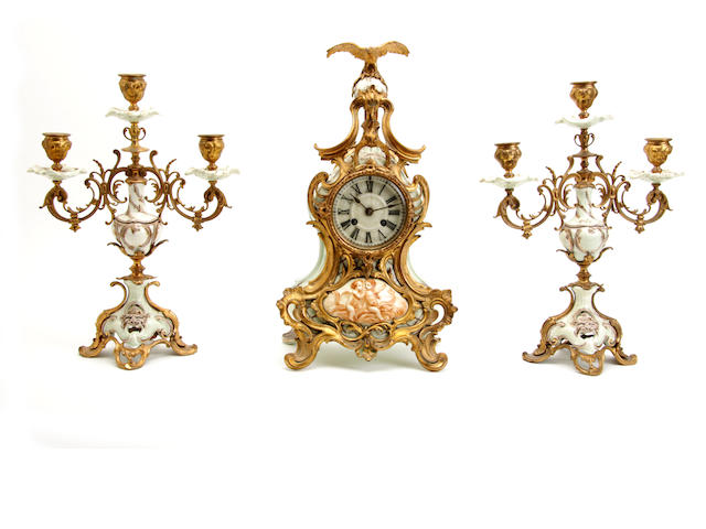 An early 20th century continental pottery and gilt metal clock garniture 3
