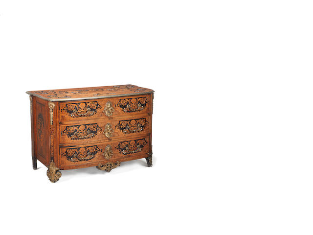 A Regence walnut, elm, ebonised, bone and stained fruitwood marquetry and gilt bronze mounted commode in the manner of Hache