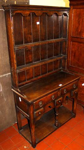 A small reproduction oak high dresser