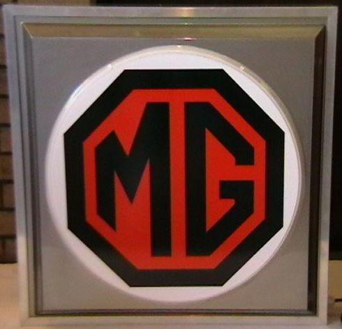 An MG illuminated garage sign,