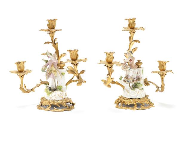 A rare pair of Meissen figures mounted on ormolu candelabra, circa 1755