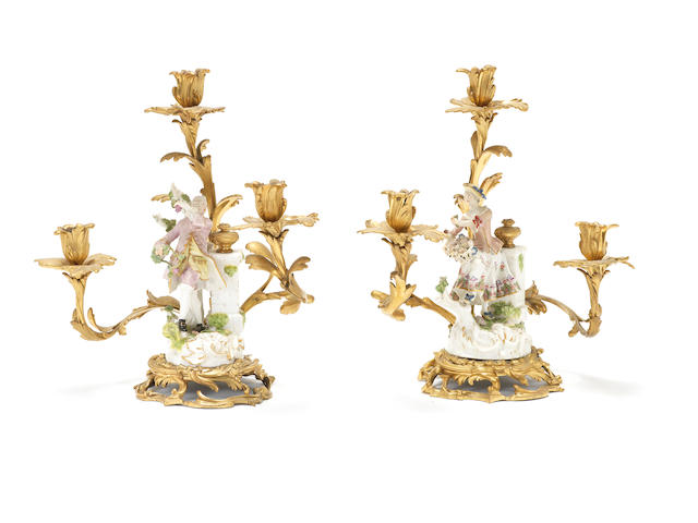 A rare pair of Meissen figures mounted on ormolu candelabra, circa 1755
