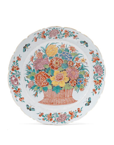 A Dutch Delft dore plate with large flower spray (some minor typical chips)