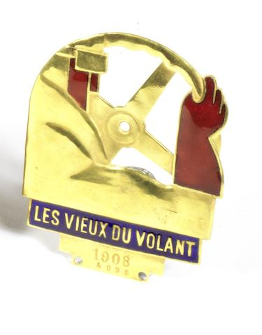 A rare Les Vieux Du Volant enamelled badge, French,