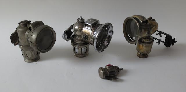 Four pre-War motorcycle lamps,
