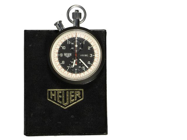 A Heuer coated stainless steel manual wind 1/10th second chronograph timepiece Circa 1960 (2)