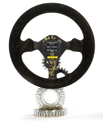 A Nigel Mansell signed steering wheel from the Portuguese GP 1984.