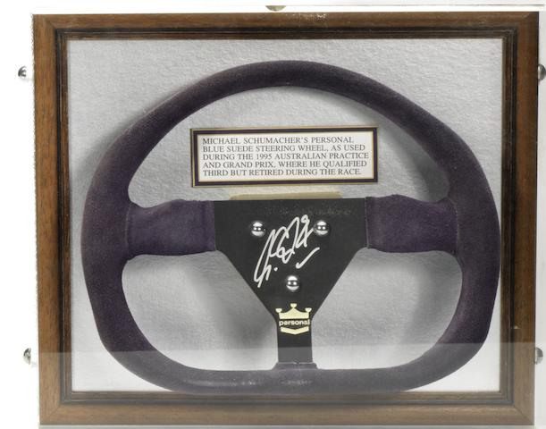 A Michael Schumacher signed steering wheel,