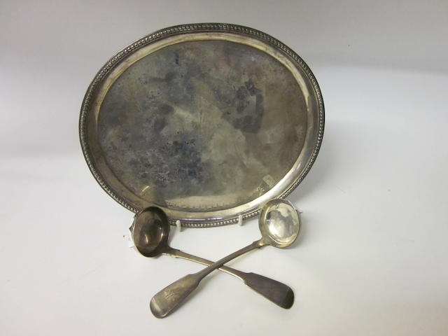 A George III Scottish oval silver waiter no makers mark, Edinburgh 1786 incuse mark  (3)