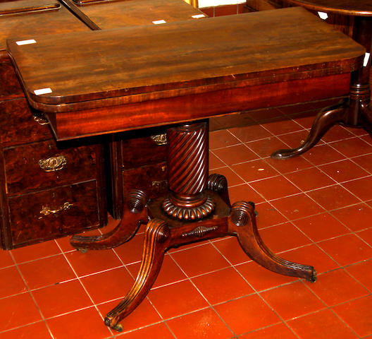 A pair of early 19th Century card tables,