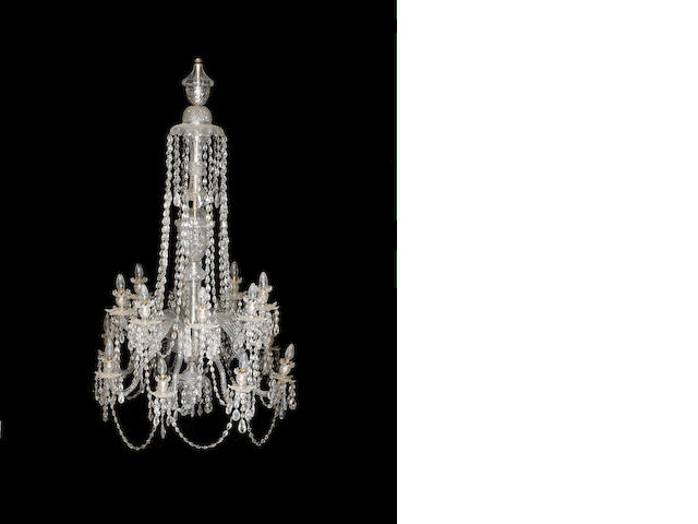 A large late 19th century sixteen light cut glass chandelier together with an associated carved giltwood ceiling rose