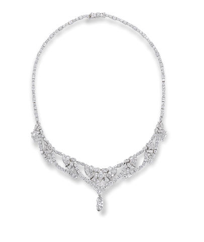 A coloured diamond and diamond necklace