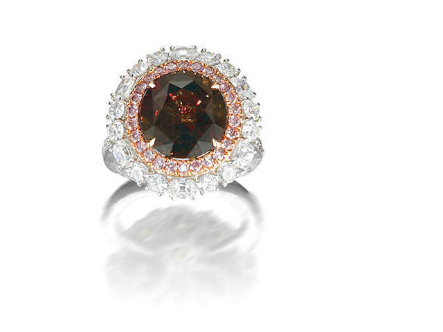 An alexandrite, coloured diamond and diamond ring