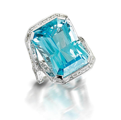 A topaz and diamond dress ring