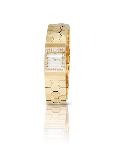 A gold and diamond quartz bracelet watch, by Van Cleef & Arpels