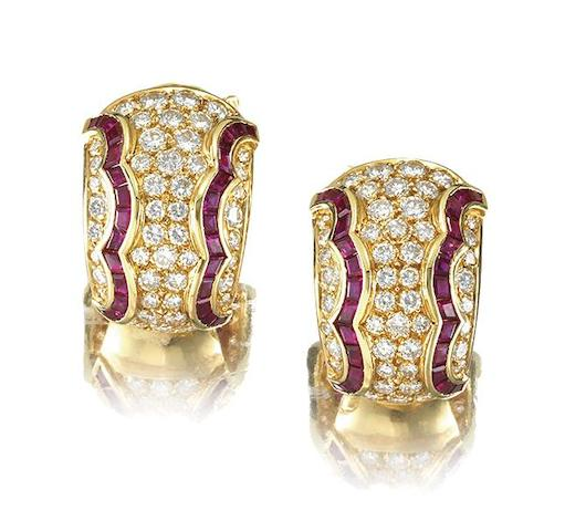 A pair diamond and ruby earclips, by Van Cleef & Arpels