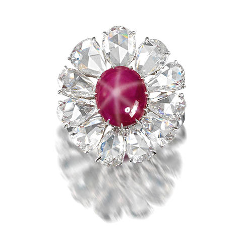 A star ruby and diamond cluster ring