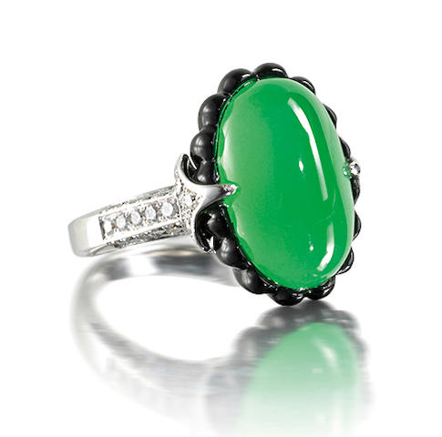 A jadeite, onyx and diamond ring