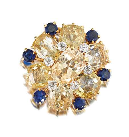 A yellow sapphire, sapphire and diamond brooch, by Cartier