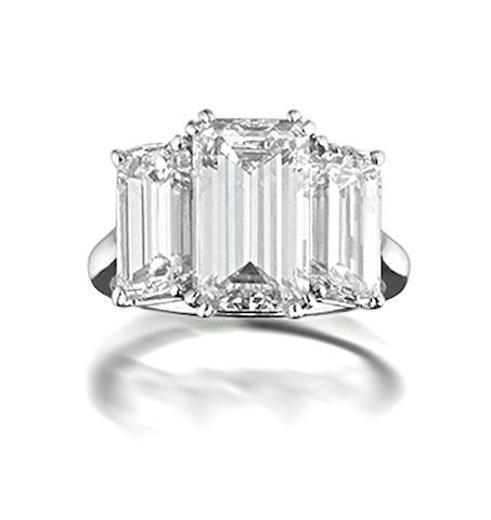 An impressive three-stone diamond ring, by Harry Winston