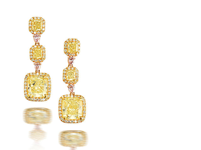 A pair of coloured diamond pendent earrings