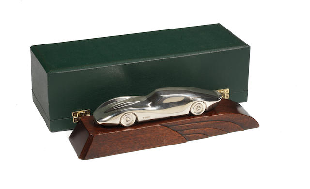 A stylised sterling silver deskpiece model of an Aston Martin,