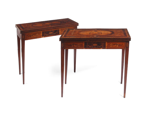 A pair of George III mahogany foldover card tables