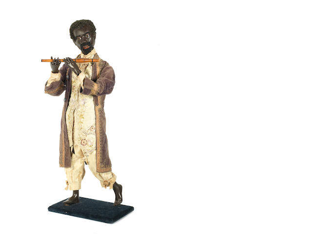 "Black flautest automata  by G. Vichy, circa 1870 See ""Automata. The Golden Age 1848-1914"" by Christian Bailly pg.72 for similar Automata."