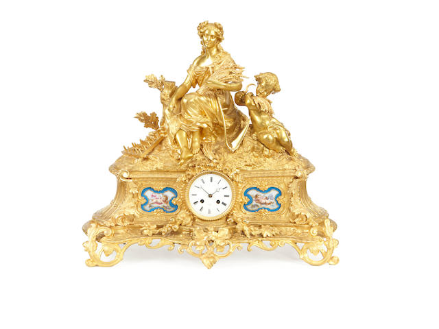 A large late 19th century ormolu and porcelain mounted figural mantel clock by H. Marc, Paris