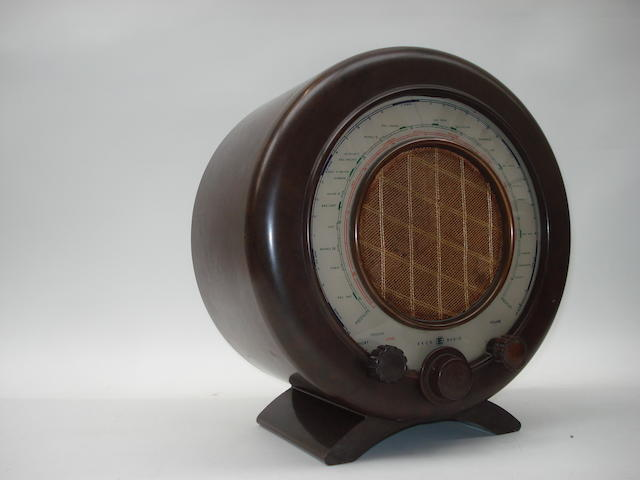 An Ecko AD75 circular brown Bakelite radio